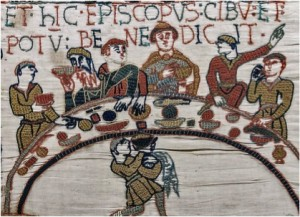 Image depicting bards singing at a banquet on the Bayeux Tapestry.