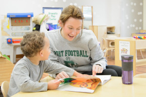 A UW Oshkosh student works with a child through her job at the Children's Learning and Care Center