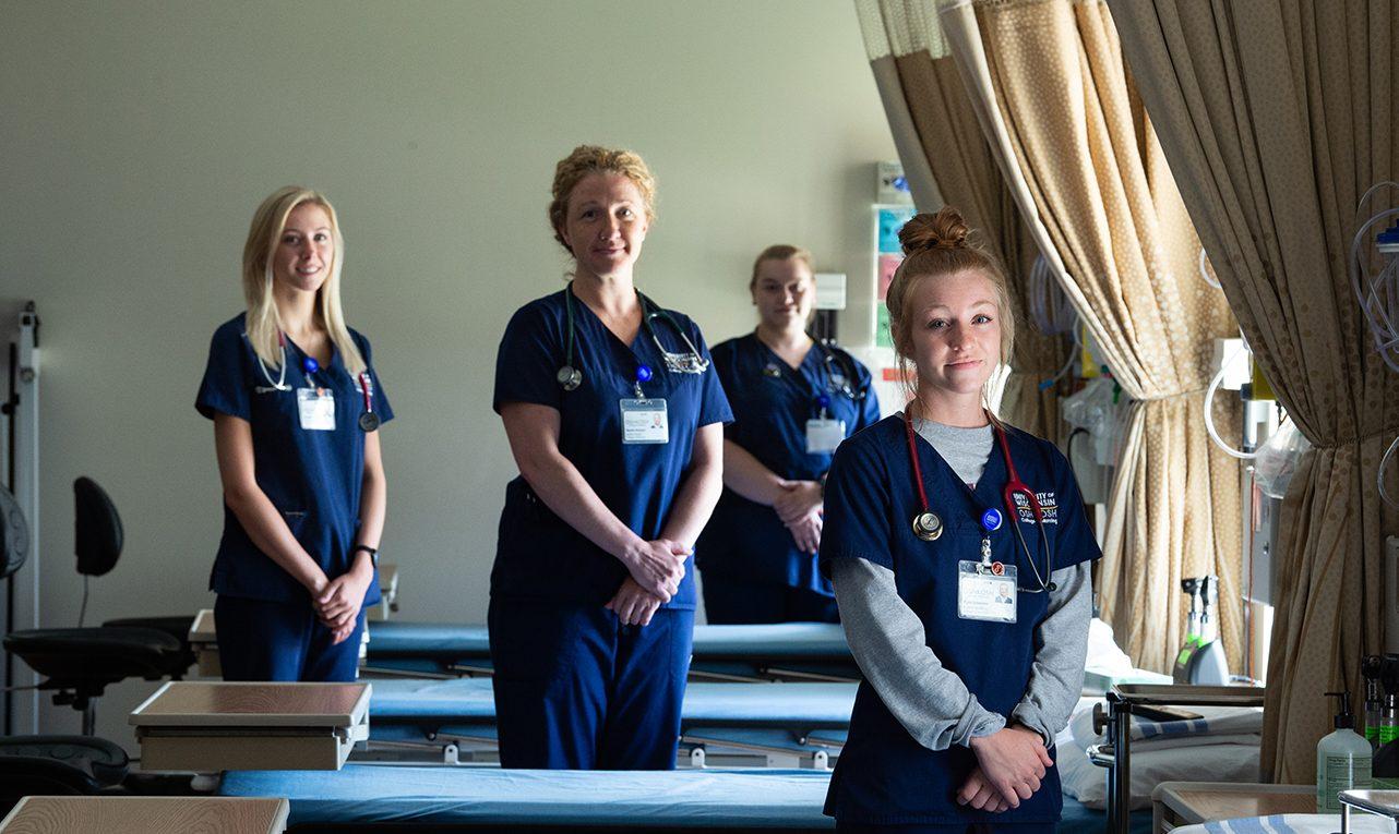 Nursing students in graduate laboratory