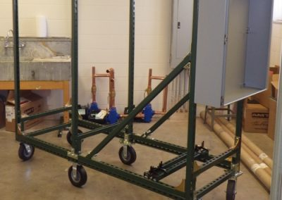 Frame with casters and electrical box