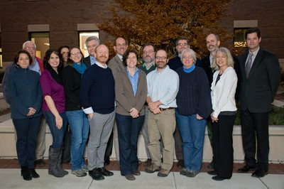 A group photo of the History Department Faculty and Staff in the Sage Hall courtyard