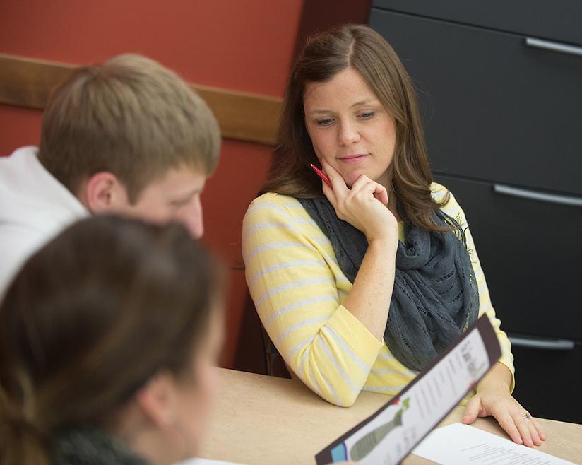 Instructor Dana Baumgart advising students