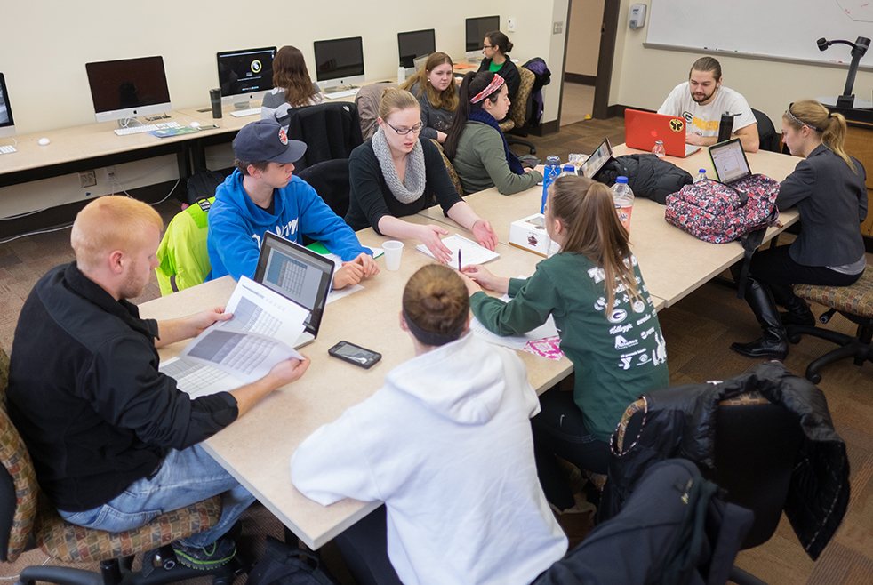Journalism students working on a group project