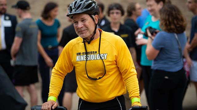 UWO prof triumphant in bicycle ride across Wisconsin for scholarships