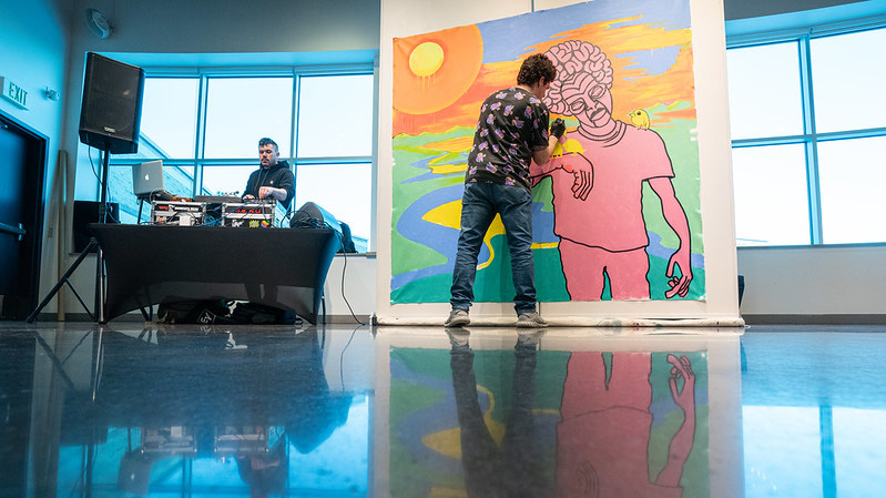 Fox Cities alumnus grooves to live music while painting