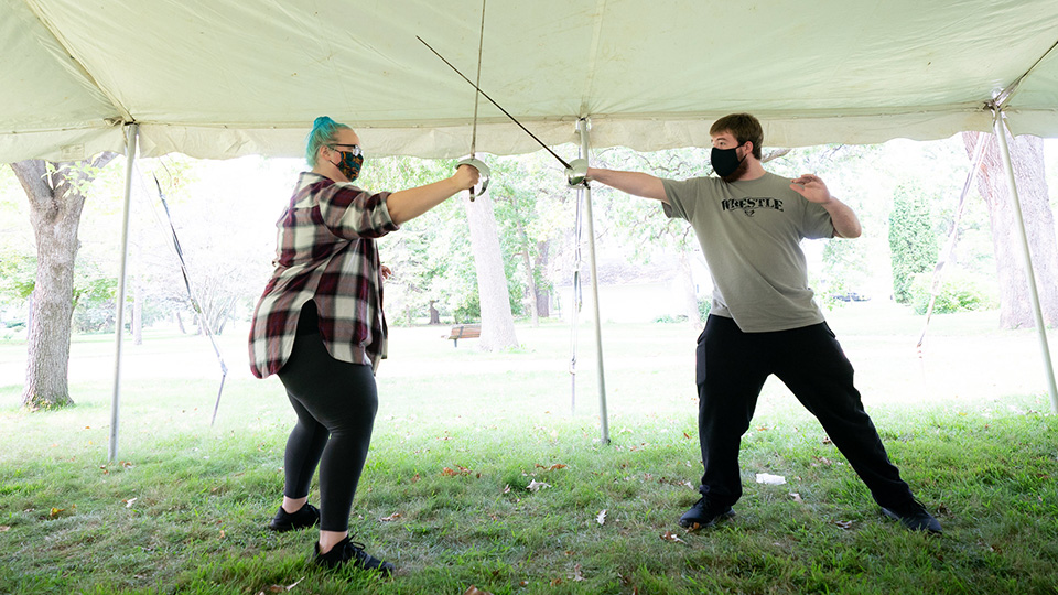 UWO performing arts students learning outdoors in tent erected near AC Center