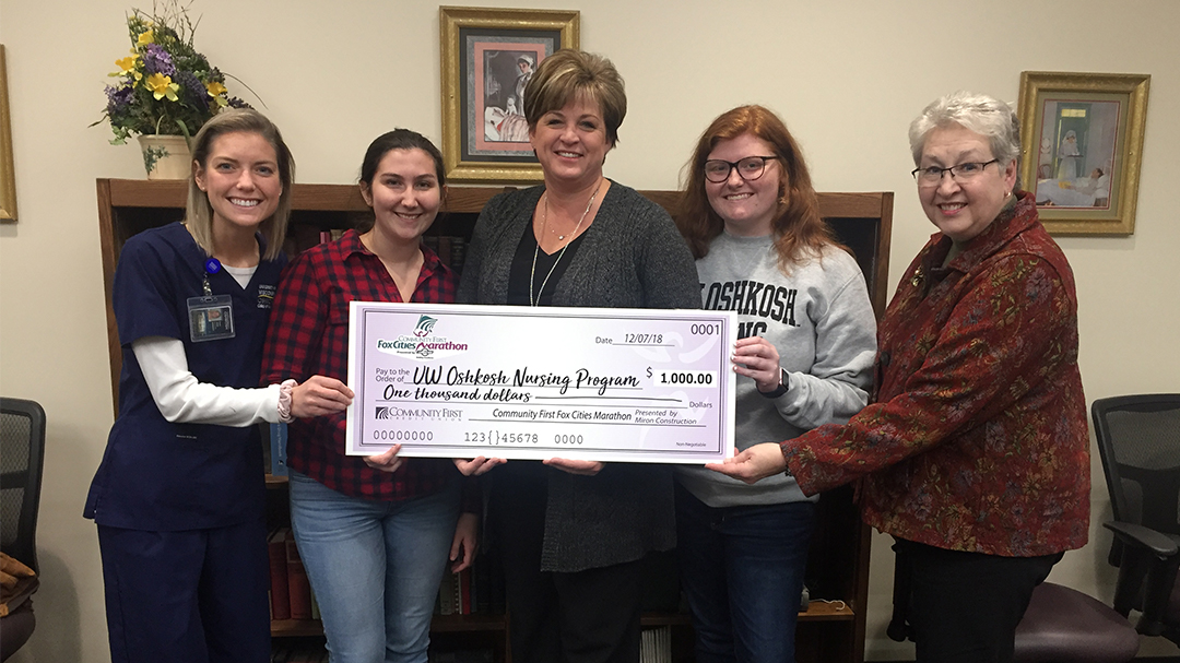 CON receives $1,000 donation for outstanding student service
