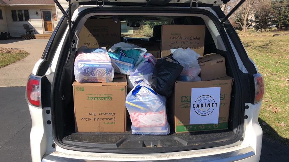 Donating it forward: UWO's Cabinet delivers goods to Oshkosh food pantry
