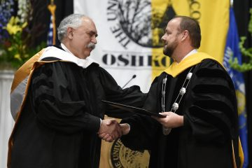 Stan Mack shakes hands with Chancellor Andrew Leavitt