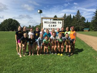 Community service, team bonding at camp a highlight for UW