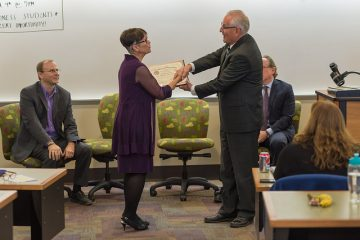 Marnocha accepting award on behalf of CON