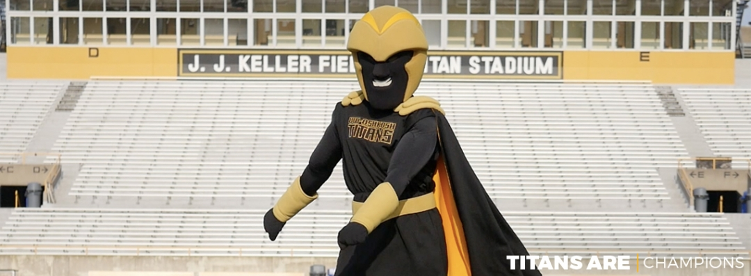 "Clash the Titan ""flosses"" in front of the stands at J. J. Keller Field at Titan Stadium."